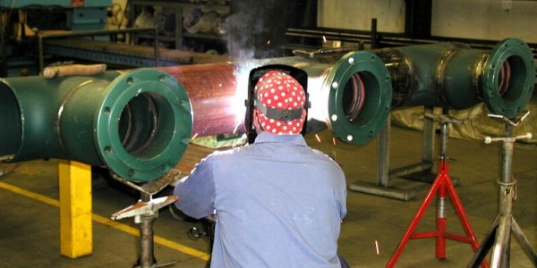 BSIW Employee Fabricating Pipe
