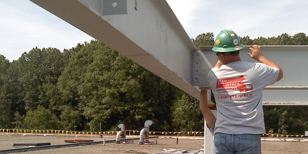 BSIW Employee Installing I-Beams