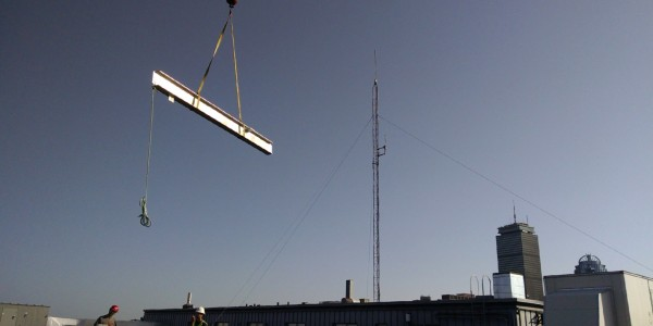 BSIW Hoisting a Beam for Installation on a Rooftop in Boston, MA