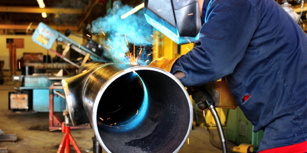 BSIW Employee Welding Pipe in Our Fabrication Shop
