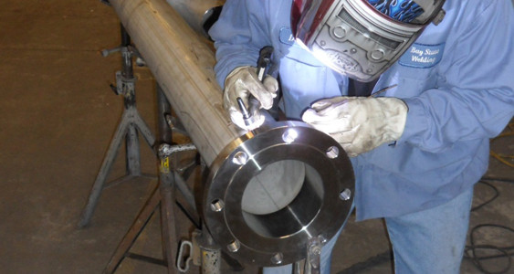 BSIW Employee TIG Welding a Stainless Steel Pipe and Flange